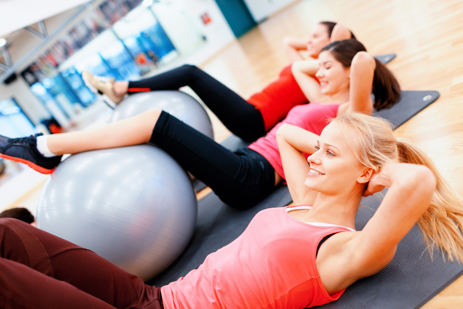 photodune-8696272-group-of-people-working-out-in-pilates-class-l
