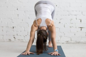 flexible-woman-stretching-her-back-and-arms_1218-398